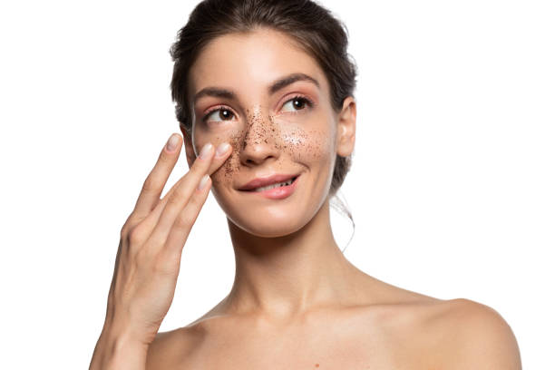 Close up portrait of woman apply face skin scrub stock photo