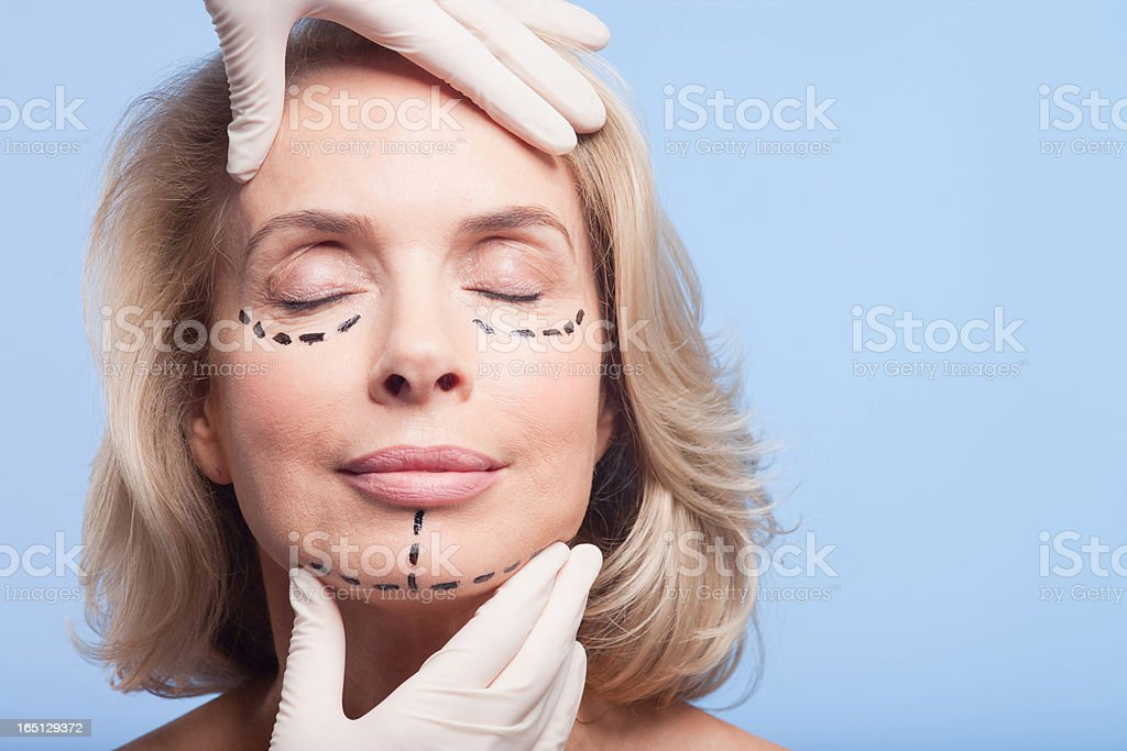 Close up portrait of woman with dotted lines on face stock photo