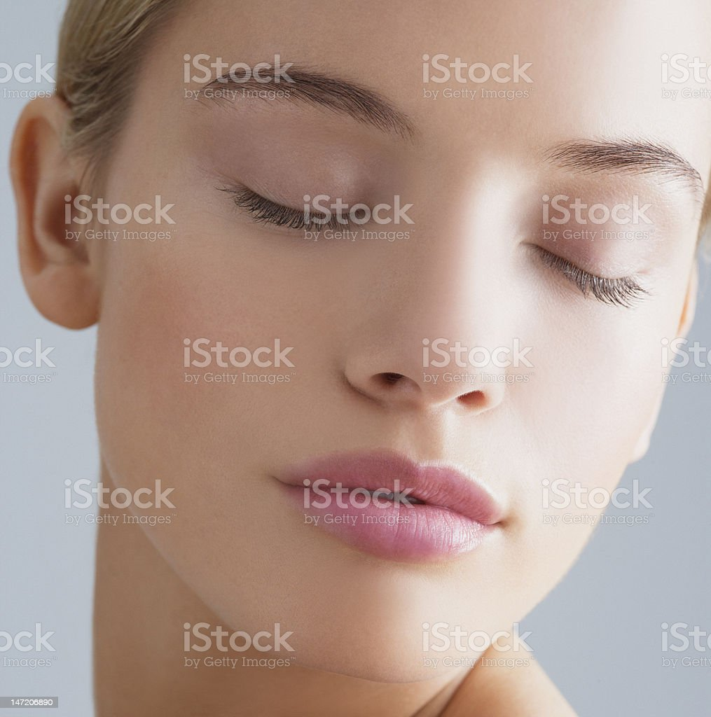 Close up portrait of woman with eyes closed stock photo