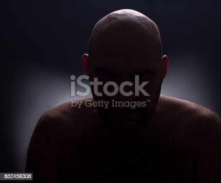 1162960006istockphoto Close up portrait of worrying bald man. 852456308