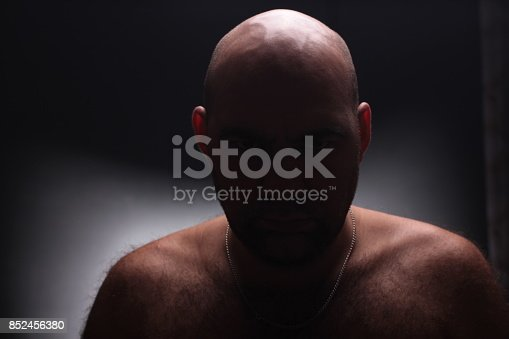 1162960006istockphoto Close up portrait of worrying bald man. 852456380