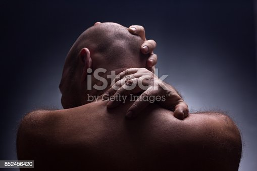1162960006istockphoto Close up portrait of worrying bald man. 852456420