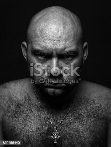 1162960006istockphoto Close up portrait of worrying bald man. 852456440