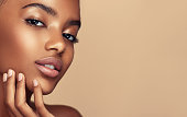 istock Close up portrait of young, beautiful model with with vibrant, melanin-rich skin tone. Beauty and makeup. 1281698403