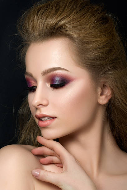 close up portrait of young beautiful woman with fashion makeup - metallisches make up stock-fotos und bilder