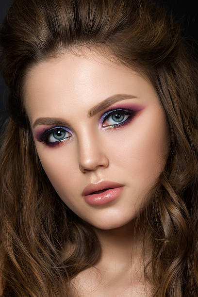 close up portrait of young beautiful woman with fashion makeup - lila augen make up stock-fotos und bilder
