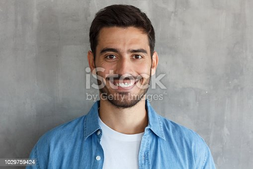 Close up portrait of young happy smiling friendly man