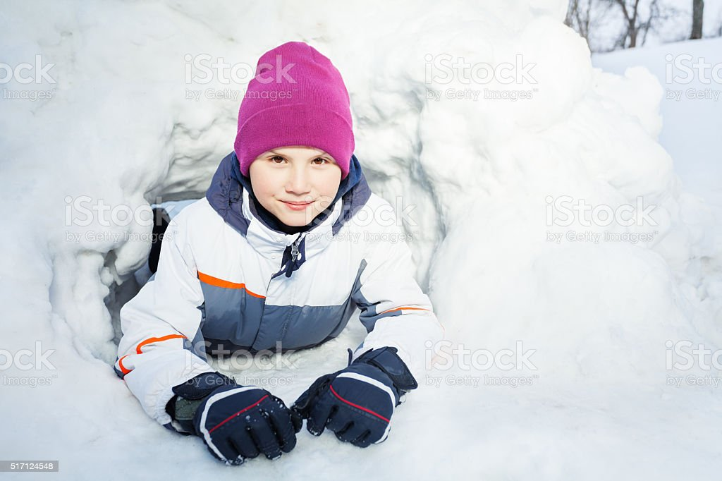 Close up portrait of young kid playing in the snow stock photo