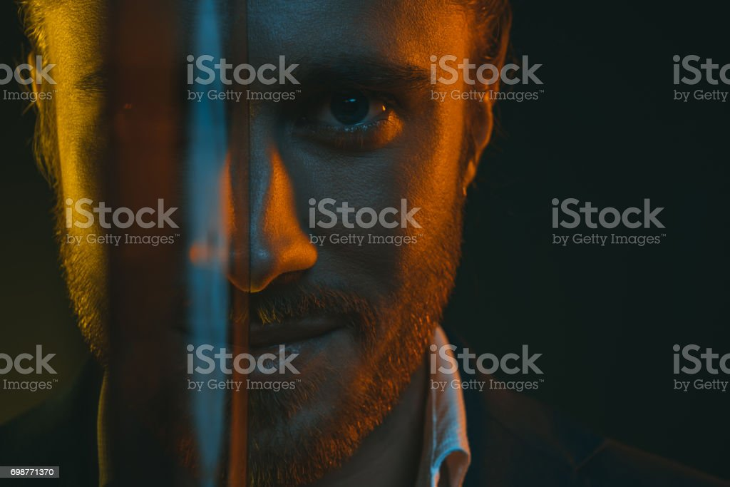 close up portrait of young man reflected in vinyl record stock photo