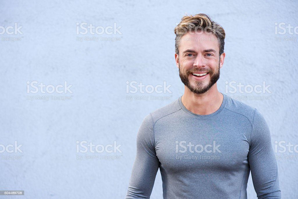 Close up portrait sports trainer smiling stock photo