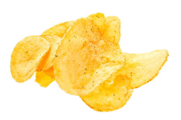 close up potato chips isolated on white background. - chipsy zdjęcia i obrazy z banku zdjęć