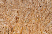 close up pressed wooden panel background, seamless texture of oriented strand board - OSB wood - Image