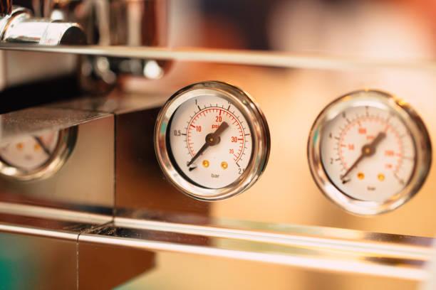 close up pressure gauge pound per square inch (psi) at coffee espresso machine stock photo