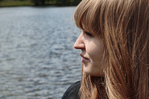 beautiful latvian girl in profile water background - whiteway latvian outdoor girl stock photos and pictures