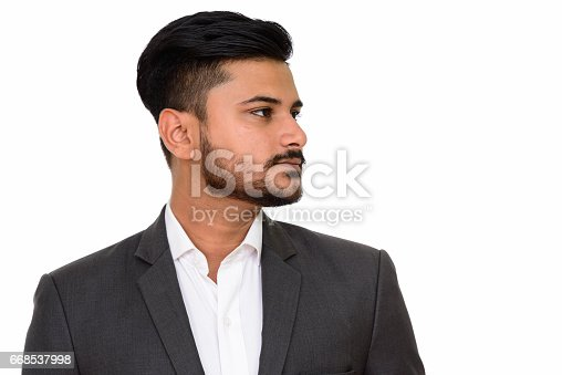 istock Close up profile view of young handsome Indian businessman 668537998