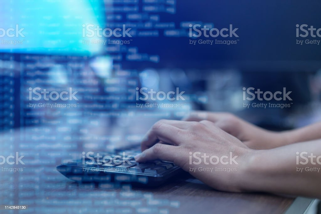 close up programmer man hand typing on keyboard at computer desktop for input coding language to software for fix bug and defect of system in operation room , technology concept close up programmer man hand typing on keyboard at computer desktop for input coding language to software for fix bug and defect of system in operation room , technology concept Accessibility Stock Photo