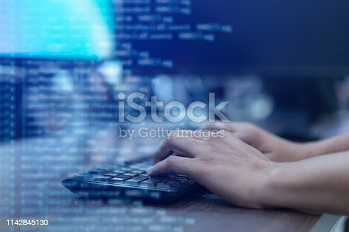 close up programmer man hand typing on keyboard at computer desktop for input coding language to software for fix bug and defect of system in operation room , technology concept