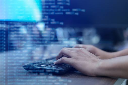 Close Up Programmer Man Hand Typing On Keyboard At Computer Desktop For Input Coding Language To Software For Fix Bug And Defect Of System In Operation Room Technology Concept Stock Photo - Download Image Now
