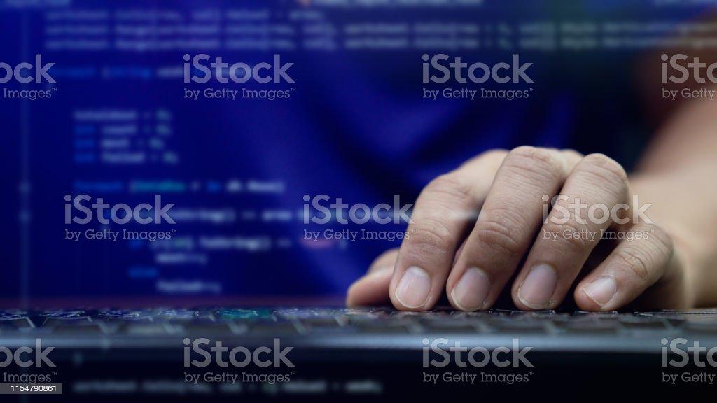 close up programmer man hand typing on keyboard at computer desktop...