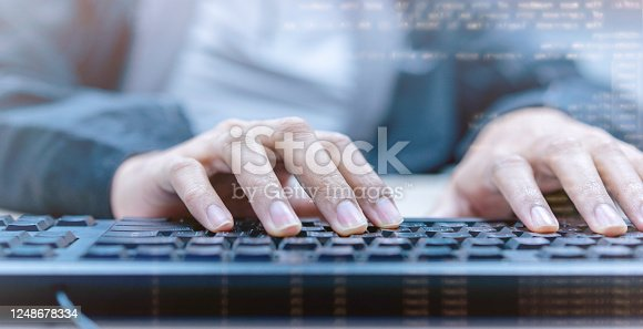 957759714 istock photo close up programmer man hand typing on keyboard computer desktop to input code language into software for solve problems about bug,malware and defect of system at office for  development of technology concept 1248678334