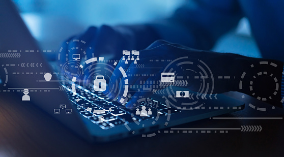 Close Up Programmer Man Hand Typing On Keyboard Laptop For Register Data System Or Access Password With Virtual Interface Of Cyber Security At Dark Operation Room Concept Stock Photo - Download Image Now