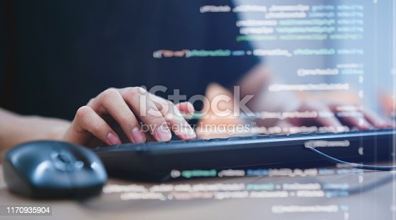 close up programmer student man hand typing on keyboard at computer desktop  to input code language into software for study bug and defect of system in classroom , development of technology concept