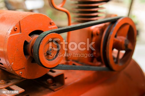 841283930 istock photo close up pulley and belt drive. machine composed of pulley and a belt. 961573086