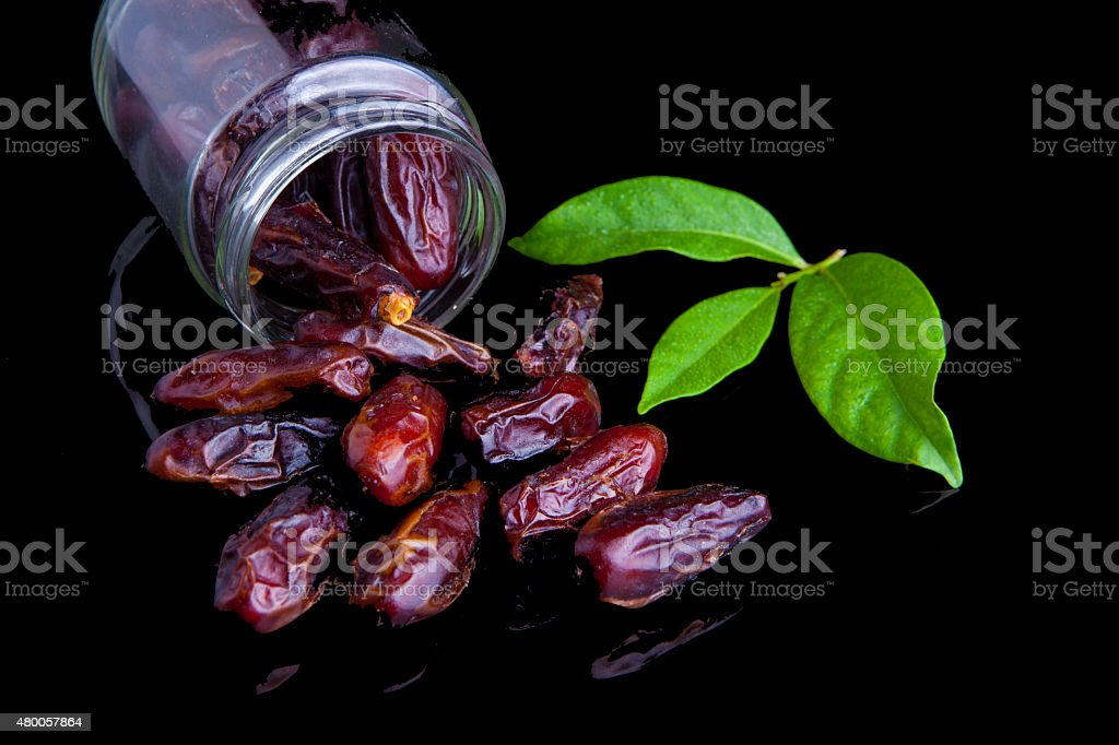 Close up Ramadan Food Date fruit with green leaf stock photo