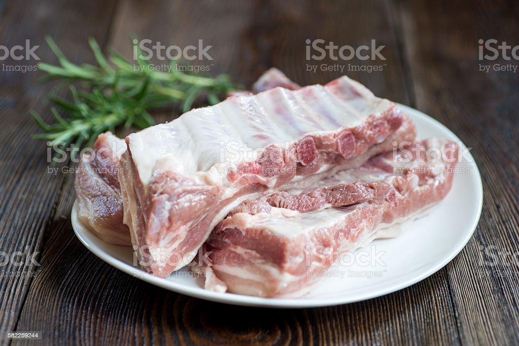 Close up Raw Pork Rib meat on white dish stock photo
