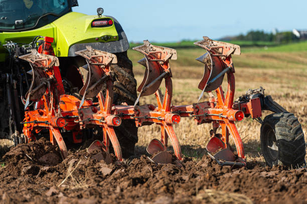 Close up rear view of ploughing in a field in Dumfries and Galloway south west Scotland A plough being used in late summer to prepare a field and make it ready to sow a new crop to harvest next year johnfscott stock pictures, royalty-free photos & images