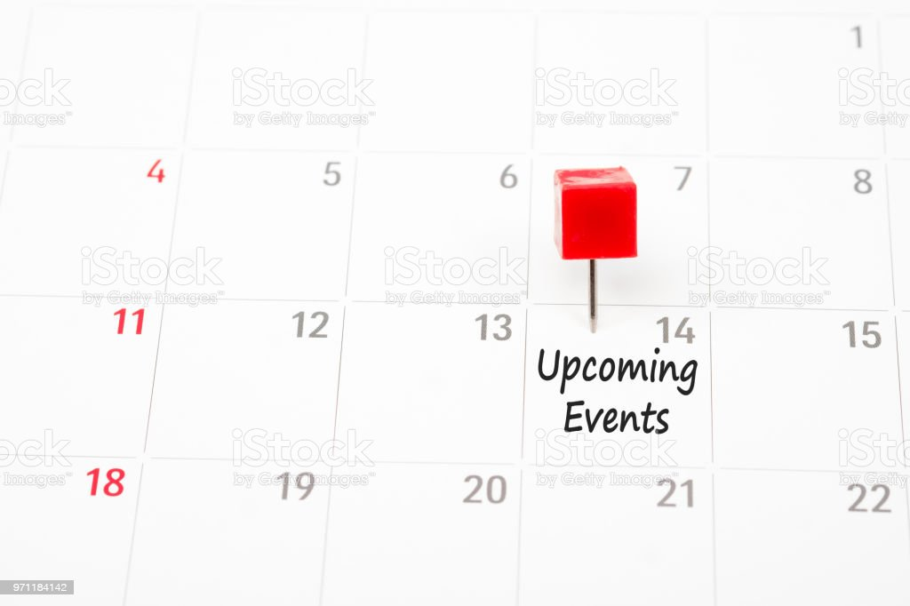 Close up red pin on White Calendar. stock photo