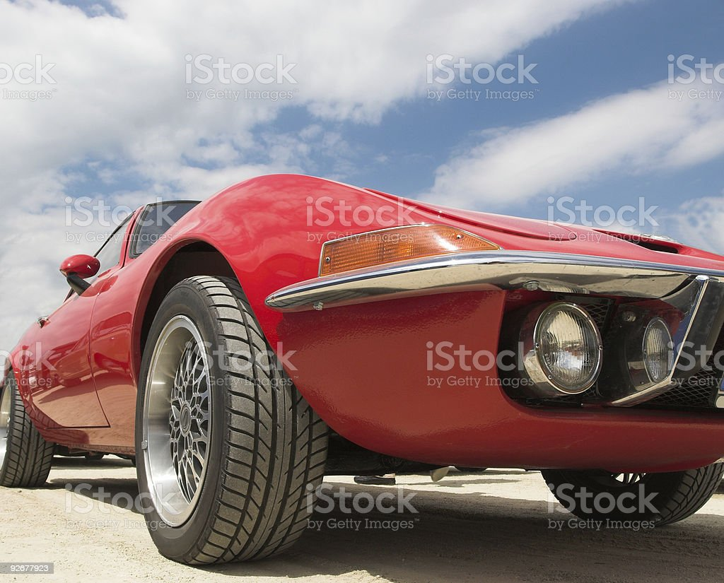 Close up red vintage sports car viewed from passenger side royalty-free stock photo