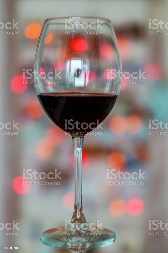 Close up, red wine glass on a bokeh background. Concept holiday.