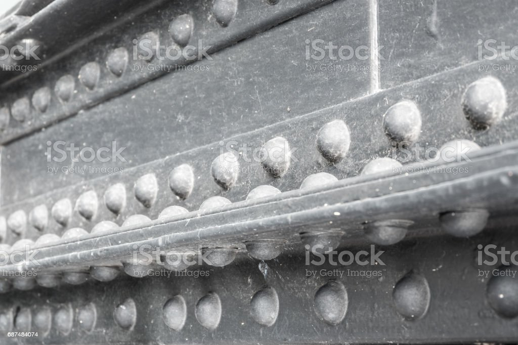 Close up riveted steel of the bridge stock photo