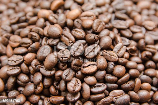 867484488 istock photo close up roasted coffee beans, can be used as a background 859481780