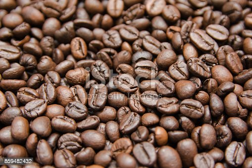 867484488 istock photo close up roasted coffee beans, can be used as a background 859482432