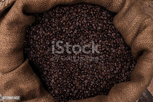 istock Close up roasted dark coffee beans. 672961402
