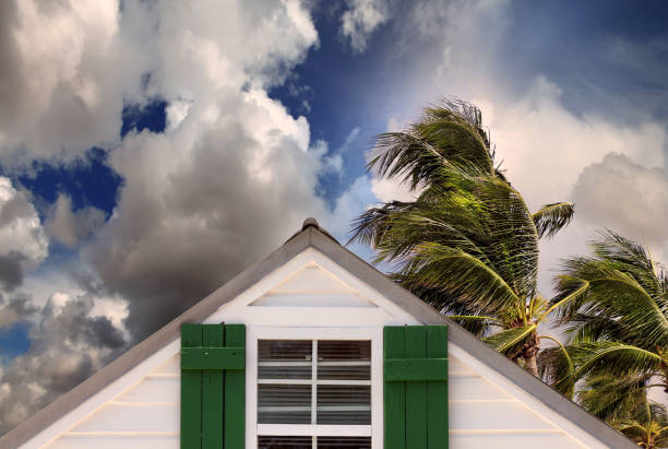 close up rooftop of a wooden house in tropical storm stock photo