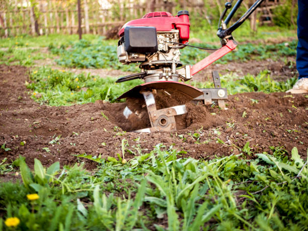 close up rotating cultivating tiller in the garden close up rotating cultivating tiller in the garden garden hoe stock pictures, royalty-free photos & images