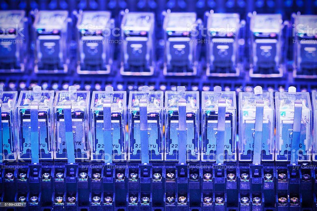 Close up row of Relay actuators stock photo
