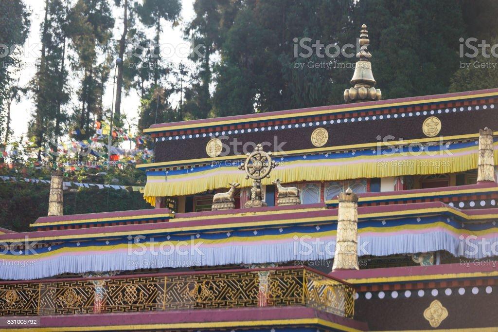 Close up Rumtek Monastery with pines on the top near Gangtok. Sikkim, India stock photo