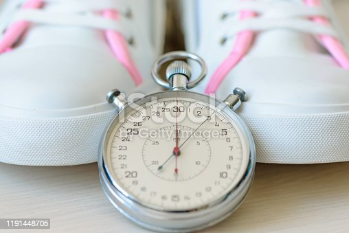 Running Shoes And Stopwatch. Time to run and play sports. Training, jog and sport concept. Close up.