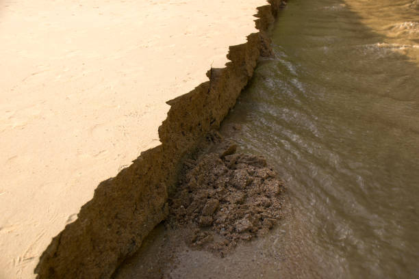 Close up Sandbank was eroded with water. stock photo