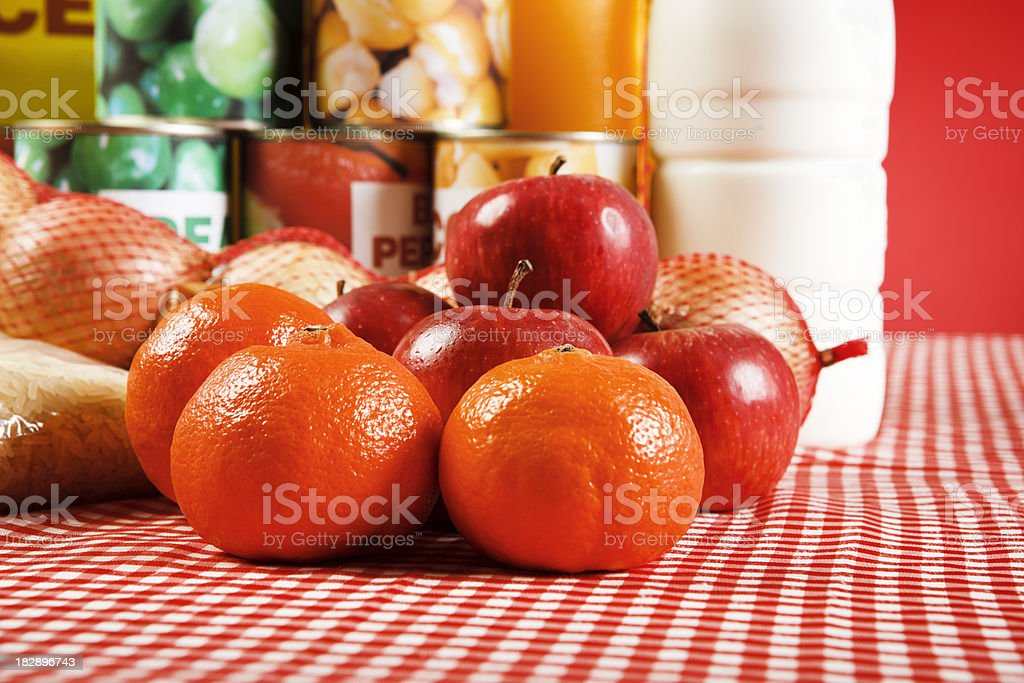 Close up selection of basic foods on red checked tablecloth stock photo