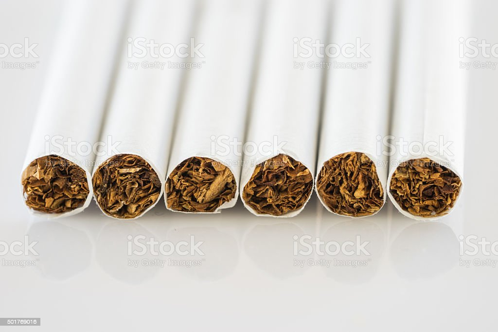 close up set of cigarettes on white background stock photo