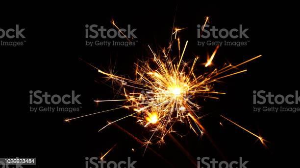 Photo of Close up several firework sparklers over black