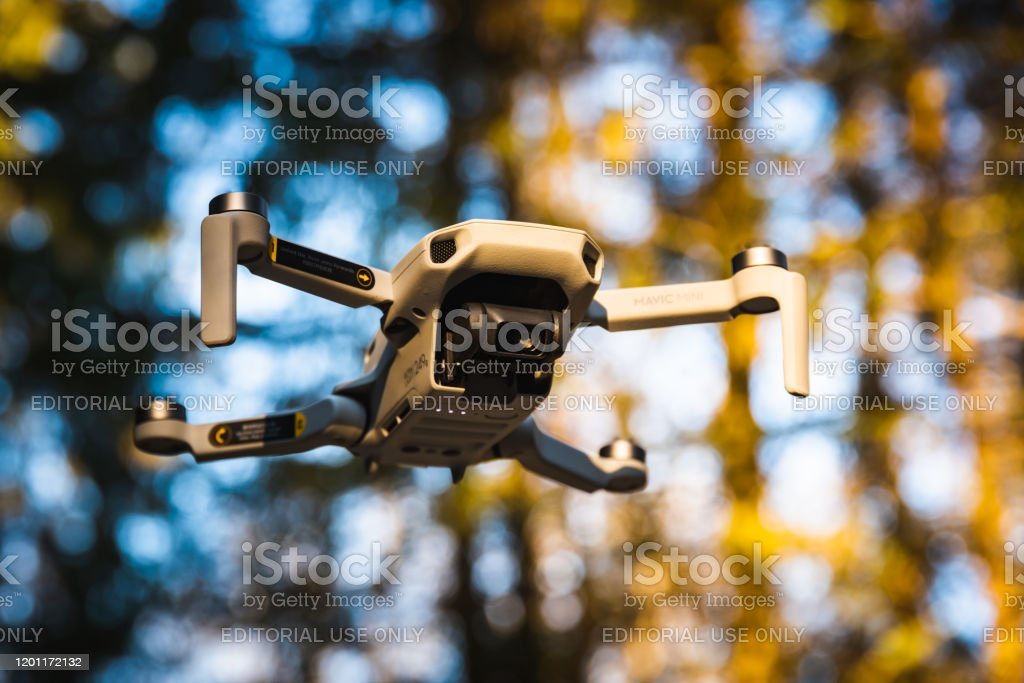 Close Up Shoot Of A Dji Quadcopter Drone Mavic Mini 249g Drone Flying In Sunny Forest Stock Photo Download Image Now Istock