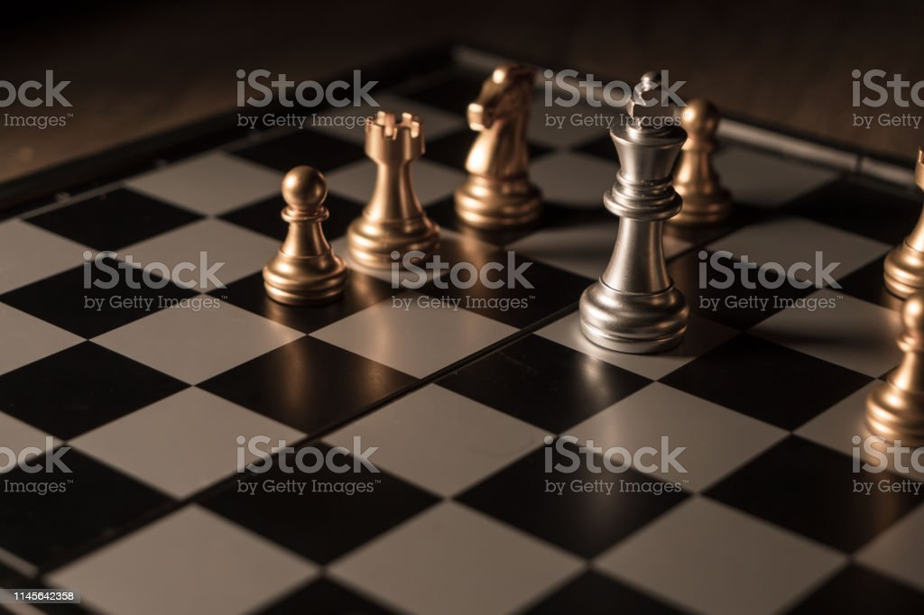Close up shot chess on the board game with dark mood and tone process...
