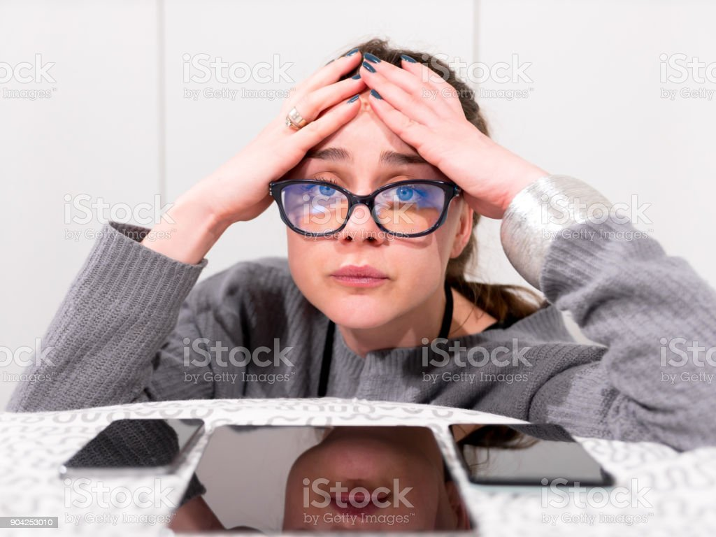 Close up shot of a girl who can't take anymore internet and digital devices looking at camera stock photo
