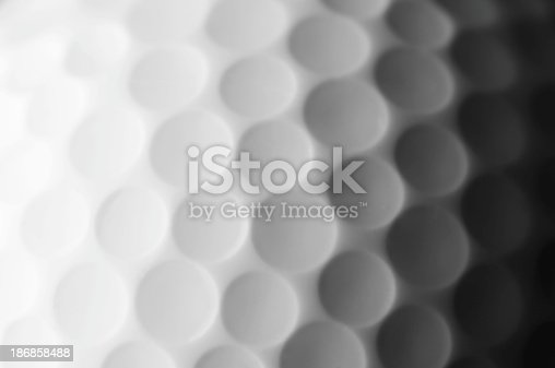 istock A close up shot of a golf ball, white and fade to dark gray 186858488